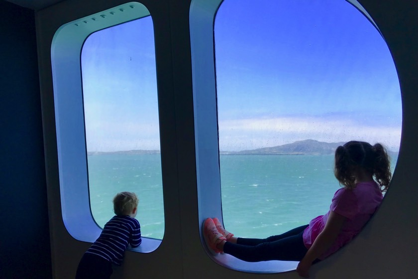 Children looking out a ferry window